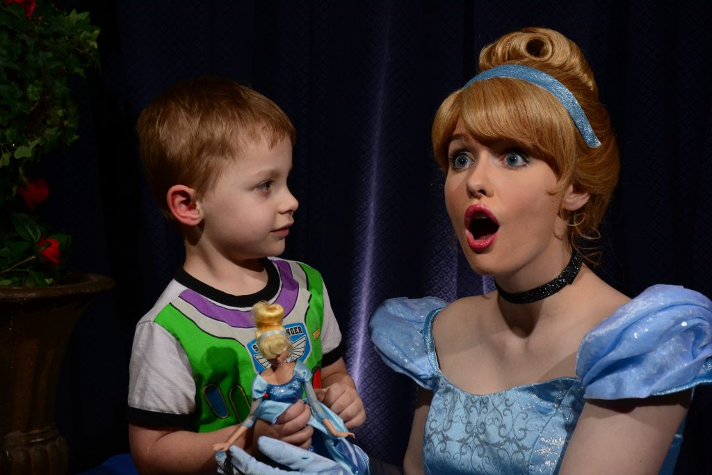 Cinderella with surprised face with my son holding his Cinderella doll.